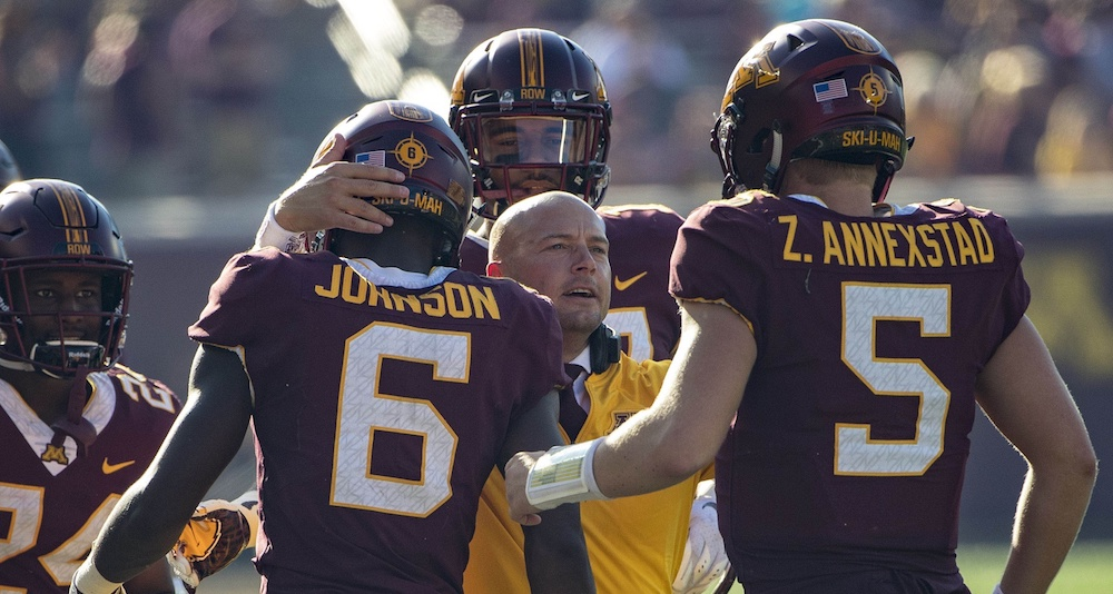 Sep 15, 2018; Minneapolis, MN, USA; Minnesota Golden Gophers head coach P.J. Fleck smiles with wide receiver Tyler Johnson (6) and quarterback Zack Annexstad (5) after a touchdown in the second half against the Miami (Oh) Redhawks at TCF Bank Stadium. Mandatory Credit: Jesse Johnson-USA TODAY Sports