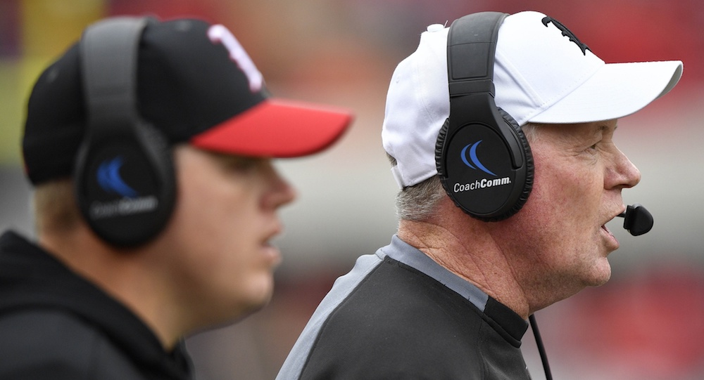 Oct 27, 2018; Louisville, KY, USA; Louisville Cardinals head coach Bobby Petrino calls out instructions alongside his son and quarterbacks coach Nick Petrino during the second half against the Wake Forest Demon Deacons at Cardinal Stadium. Wake Forest defeated Louisville 56-35. Mandatory Credit: Jamie Rhodes-USA TODAY Sports