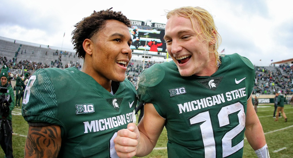 Oct 27, 2018; East Lansing, MI, USA; Michigan State Spartans quarterback Rocky Lombardi (12) and Michigan State Spartans wide receiver Jalen Nailor (8) celebrate a victory over the Purdue Boilermakers after a game at Spartan Stadium. Mandatory Credit: Mike Carter-USA TODAY Sports