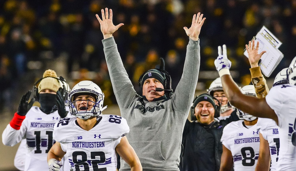 Nov 10, 2018; Iowa City, IA, USA; Northwestern Wildcats head coach Pat Fitzgerald and the Wildcats bench react during the fourth quarter after a touchdown against the Iowa Hawkeyes at Kinnick Stadium. Mandatory Credit: Jeffrey Becker-USA TODAY Sports