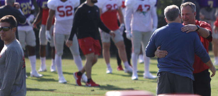 Chip Kelly hugs Bill Davis during Ohio State's practice