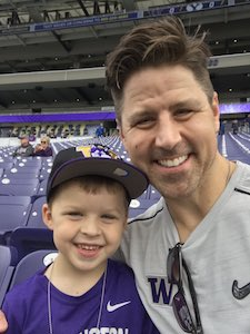 Ryan Day and his son at a Washington football game