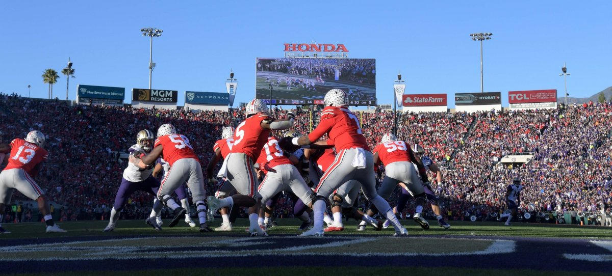 Jan 1, 2019; Pasadena, CA, USA; General overall view as Ohio State Buckeyes quarterback Dwayne Haskins (7) hands the ball off to running back Mike Weber Jr. (5) duringl the 2019 Rose Bowl against the Washington Huskies at the Rose Bowl. Ohio State defeated Washington 28-23. Mandatory Credit: Kirby Lee-USA TODAY Sports