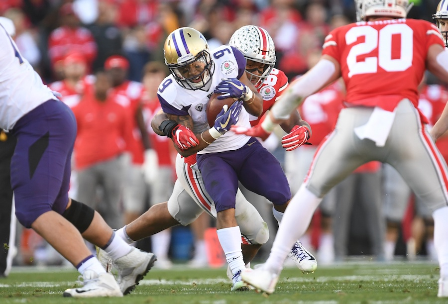 Jan 1, 2019; Pasadena, CA, USA; Ohio State Buckeyes defensive tackle Dre'Mont Jones (86) tackles Washington Huskies running back Myles Gaskin (9) in the first half in the 2019 Rose Bowl at Rose Bowl Stadium. Mandatory Credit: Gary A. Vasquez-USA TODAY Sports
