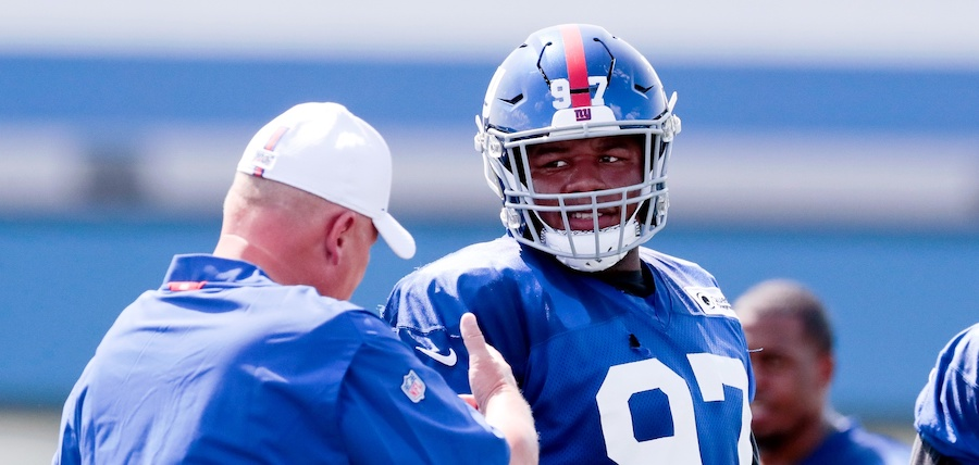 Jul 25, 2019; East Rutherford, NJ, USA; New York Giants defensive tackle Dexter Lawrence (97) talks with defensive coordinator James Bettcher during the first day of training camp at Quest Diagnostics Training Center. Mandatory Credit: Vincent Carchietta-USA TODAY Sports