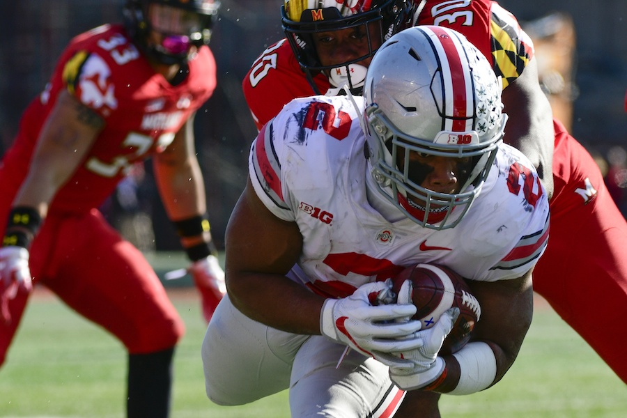 Nov 17, 2018; College Park, MD, USA; Ohio State Buckeyes running back J.K. Dobbins (2) dives for extra yards as Maryland Terrapins linebacker Durell Nchami (30) defends at Capital One Field at Maryland Stadium. Mandatory Credit: Tommy Gilligan-USA TODAY Sports