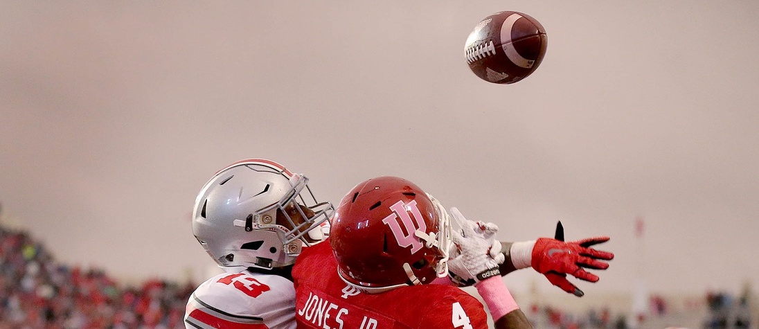 Oct 3, 2015; Bloomington, IN, USA; Ohio State Buckeyes cornerback Eli Apple (13) knocks the ball away from Indiana Hoosiers wide receiver Ricky Jones (4) on the last play of the game at Memorial Stadium. Mandatory Credit: Matt Kryger-USA TODAY Sports