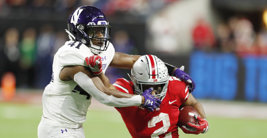 Dec 1, 2018; Indianapolis, IN, USA; Ohio State Buckeyes running back J.K. Dobbins (2) is tackled by Northwestern Wildcats safety Jared McGee (41) during the fourth quarter in the Big Ten conference championship game at Lucas Oil Stadium. Mandatory Credit: Brian Spurlock-USA TODAY Sports
