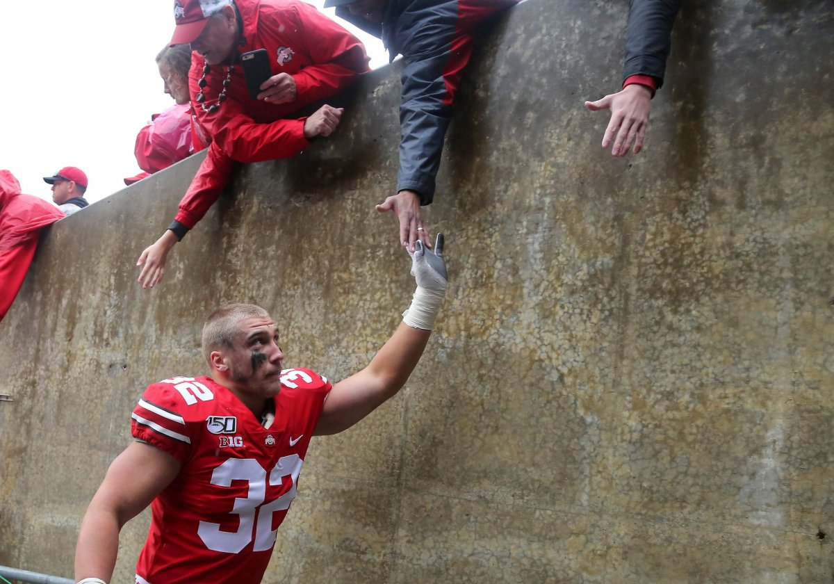 Oct 26, 2019; Columbus, OH, USA; Ohio State Buckeyes linebacker Tuf Borland (32) celebrates with fans after the game against the Wisconsin Badgers at Ohio Stadium. Mandatory Credit: Joe Maiorana-USA TODAY Sports