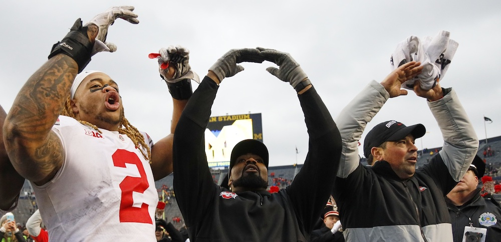 Nov 30, 2019; Ann Arbor, MI, USA; Ohio State Buckeyes defensive end Chase Young (2) linebackers coach Al Washington and head coach Ryan Day celebrate after defeating the Michigan Wolverines at Michigan Stadium. Mandatory Credit: Rick Osentoski-USA TODAY Sports
