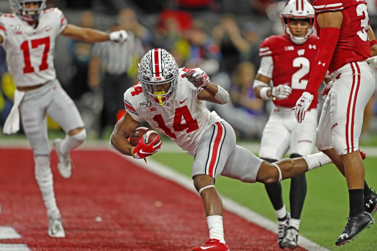 Dec 7, 2019; Indianapolis, IN, USA; Ohio State Buckeyes wide receiver K.J. Hill Jr. (14) scores a touchdown against the Wisconsin Badgers during the third quarter in the 2019 Big Ten Championship Game at Lucas Oil Stadium. Mandatory Credit: Brian Spurlock-USA TODAY Sports