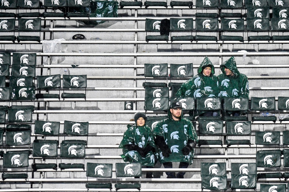 Michigan State fans sit among empty seats during the fourth quarter on Saturday, Oct. 26, 2019, at Spartan Stadium in East Lansing.