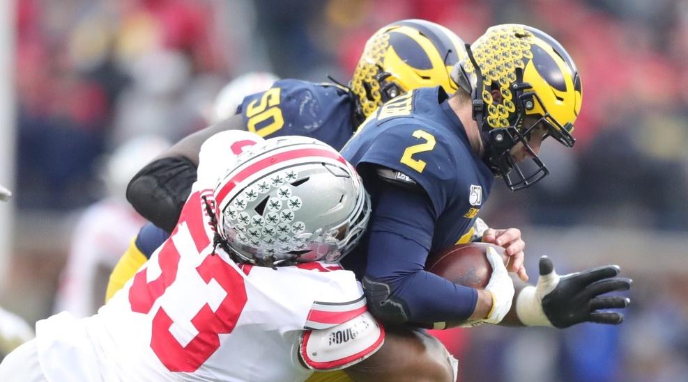 Michigan Wolverines quarterback Shea Patterson is sacked by Ohio State Buckeyes defensive tackle Davon Hamilton during the second half at Michigan Stadium in Ann Arbor, Saturday, Nov. 30, 2019. Sad Michigan football
