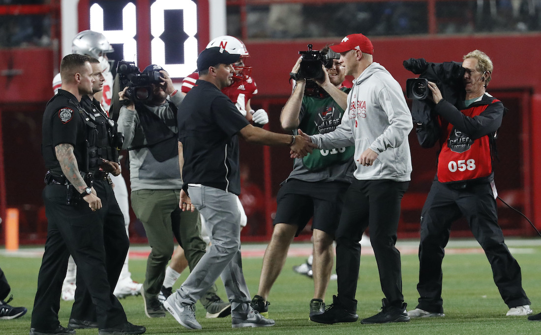 Sep 28, 2019; Lincoln, NE, USA; Ohio State Buckeyes head coach Ryan Day and Nebraska Cornhuskers head coach Scott Frost meet at midfield after the game at Memorial Stadium. Mandatory Credit: Bruce Thorson-USA TODAY Sports