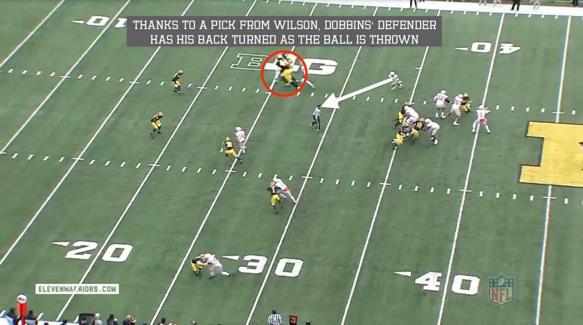 Wilson sets a pick on Dobbins' defender