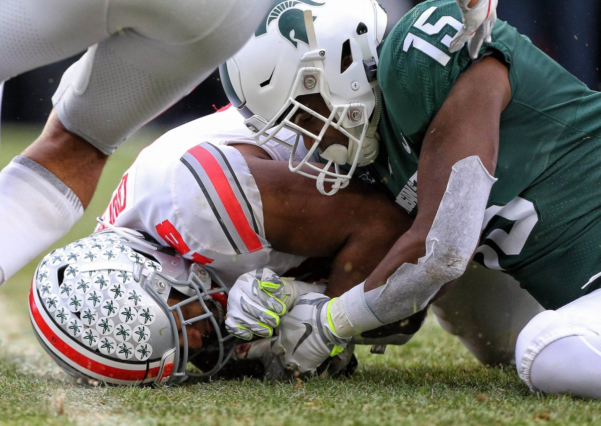 Nov 10, 2018; East Lansing, MI, USA; Ohio State Buckeyes defensive end Jonathon Cooper (18) recovers a fumble of Michigan State Spartans running back La'Darius Jefferson (15) during the second half of a game at Spartan Stadium. Mandatory Credit: Mike Carter-USA TODAY Sports