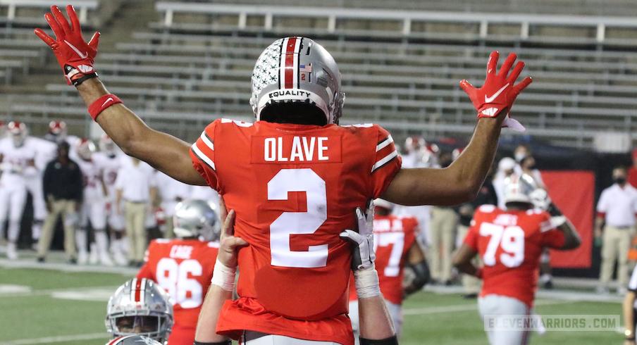 Chris Olave celebrates his touchdown