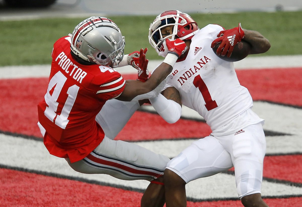 Nov 21, 2020; Columbus, Ohio, USA; Indiana Hoosiers wide receiver Whop Philyor (1) breaks the tackle of Ohio State Buckeyes safety Josh Proctor (41) and scores the touchdown during the second quarter at Ohio Stadium. Mandatory Credit: Joseph Maiorana-USA TODAY Sports
