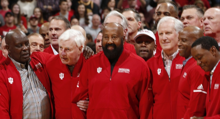 Feb 8, 2020; Bloomington, Indiana, USA; Indiana Hoosiers legendary coach Bob Knight stands between Quinn Buckner and Mike Woodson during a halftime tribute to former IU players and Coach Knight at halftime of the game against the Purdue Boilermakers at Simon Skjodt Assembly Hall. Mandatory Credit: Brian Spurlock-USA TODAY Sports
