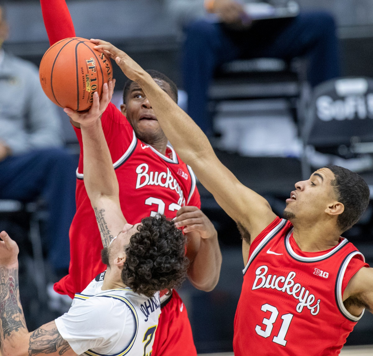 Ohio State Buckeyes forward Seth Towns (31) gets a block on Michigan Wolverines forward Brandon Johns Jr. (23) on Saturday, March 13, 2021, during the men's Big Ten basketball tournament from Lucas Oil Stadium. Ohio State Buckeyes beat Michigan Wolverines 68-67.