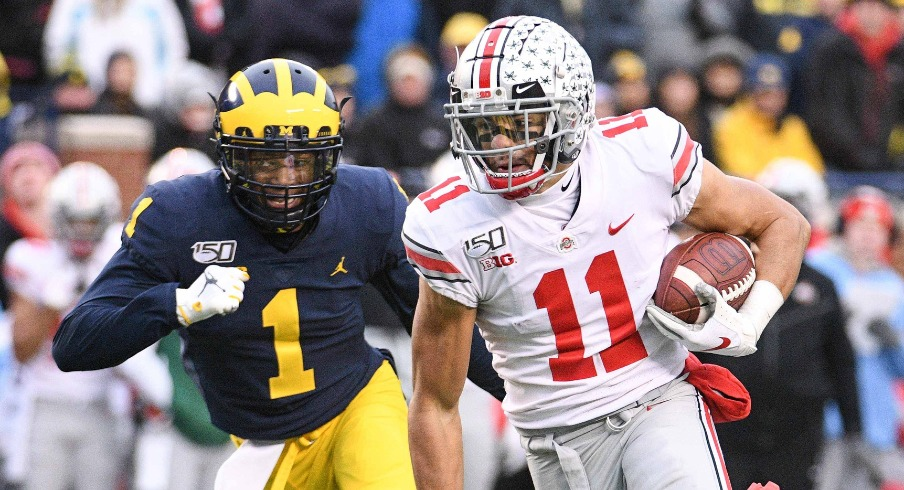 Nov 30, 2019; Ann Arbor, MI, USA; Ohio State Buckeyes wide receiver Austin Mack (11) runs for a touchdown after a completed pass during the fourth quarter against the Michigan Wolverines at Michigan Stadium. Mandatory Credit: Tim Fuller-USA TODAY Sports