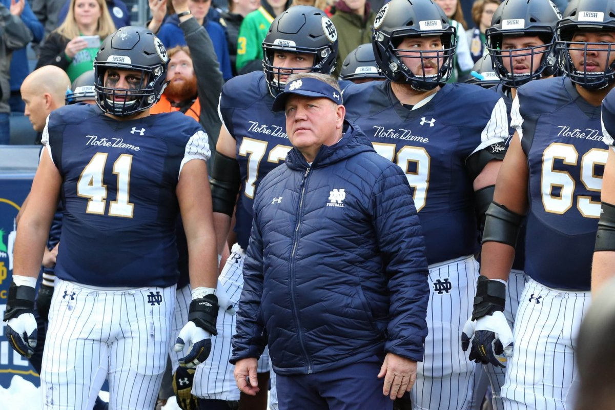 Nov 17, 2018; New York, NY, USA; Notre Dame Fighting Irish head coach Brian Kelly stands with his team prior to running on the field for the game against the Syracuse Orange at Yankee Stadium. Mandatory Credit: Rich Barnes-USA TODAY Sports
