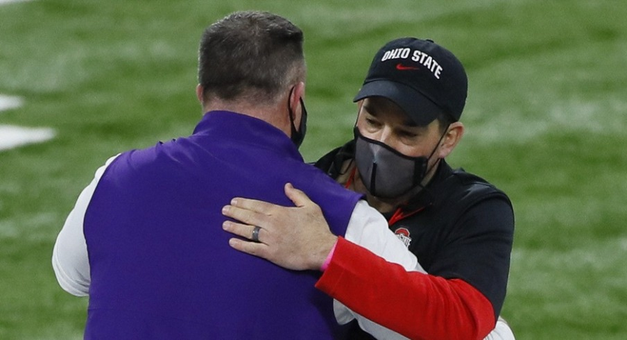 Northwestern Wildcats head coach Pat Fitzgerald hugs Ohio State Buckeyes head coach Ryan Day prior to the Big Ten Championship football game at Lucas Oil Stadium in Indianapolis on Saturday, Dec. 19, 2020. Big Ten Championship Ohio State Northwestern
