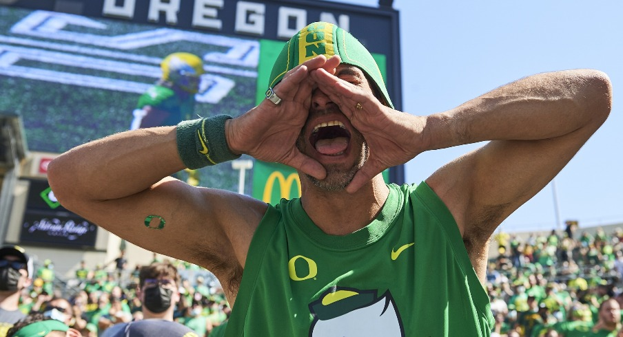 Sep 4, 2021; Eugene, Oregon, USA; An Oregon Ducks fan cheers during the second half against the Fresno State Bulldogs at Autzen Stadium. The Ducks won the game 31-24. Mandatory Credit: Troy Wayrynen-USA TODAY Sports
