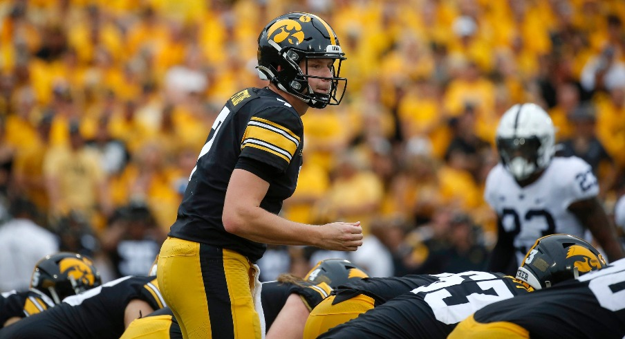 Iowa junior quarterback Spencer Petras waits for the snap in the second quarter against Penn State at Kinnick Stadium in Iowa City, Iowa, on Saturday, Oct. 9, 2021.