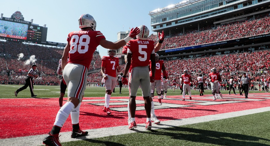 Garrett Wilson (5) celebrates after scoring a touchdown during the first quarter of a NCAA Division I football game between the Ohio State Buckeyes and the Maryland Terrapins on Saturday, Oct. 9,