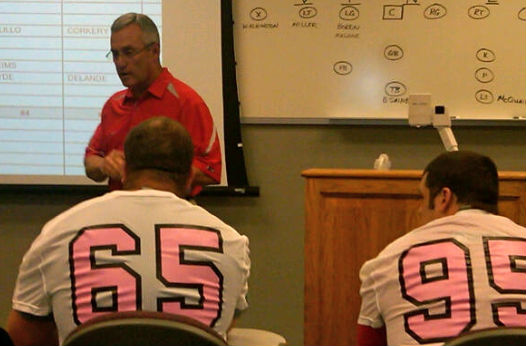Tressel administers the Spring Game Draft as Justin Boren (wearing pink-themed jersey) helps Gray select