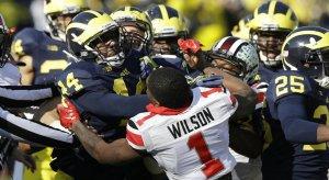 Dontre Wilson battles the entire Michigan Wolverine kickoff team.