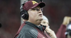 Tracy Claeys is Minnesota's new head football coach, as the school removed his interim tag Wednesday.
