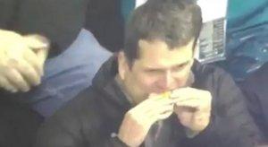 Jim Harbaugh eating a hot dog like a creep.