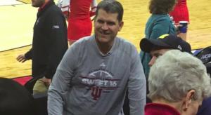 Jim Harbaugh dons Indiana shirt.
