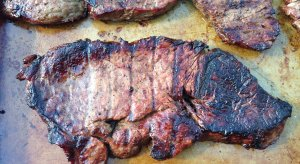 An Arkansas fan grilled a steak that looks like the Razorbacks' logo.