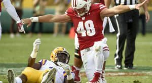 Sep 3, 2016; Green Bay, WI, USA; Wisconsin Badgers linebacker Jack Cichy (48) reacts after stopping LSU Tigers running back Leonard Fournette (7) short of a first down in the second quarter at Lambeau Field. Mandatory Credit: Benny Sieu-USA TODAY Sports