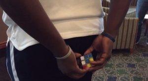 Rubik's cube behind back
