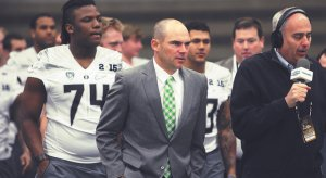 Oregon Coach Mark Helfrich leads his troops.