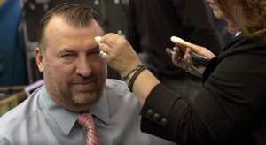 Large adult child Bret Bielema