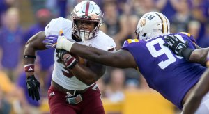 Sep 30, 2017; Baton Rouge, LA, USA; LSU Tigers nose tackle Greg Gilmore (99) tackles Troy Trojans running back Jordan Chunn (38) in the first quarter of the game between the LSU Tigers and the Troy Trojans at Tiger Stadium. Mandatory Credit: Stephen Lew-USA TODAY Sports