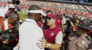 Future Florida State head coach Willie Taggart and former Florida State head coach Jimbo Fisher