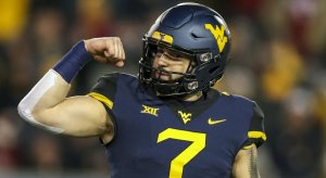 Will Grier won't play in his bowl game.
