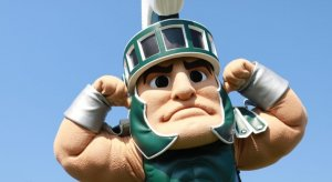 Kids pose with Sparty during the 2019 Metro Detroit Youth Day at Belle Isle Park in Detroit on Wednesday, July 10, 2019