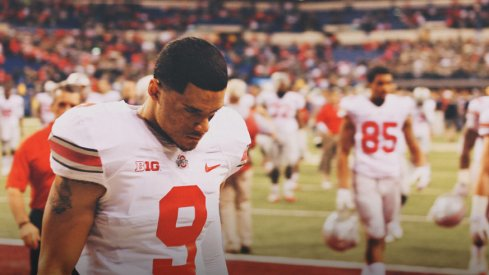 Devin Smith walks off the field dejected following Ohio State's loss to Michigan State in the Big Ten Championship Game.