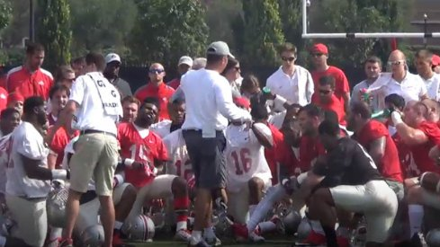 Urban Meyer speaks to his players before the first practice of fall camp.