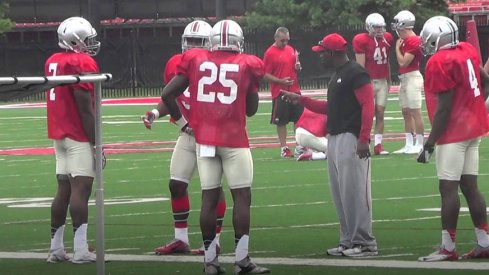 Stan Drayton works with his running backs at Ohio State fall camp practice Wednesday.