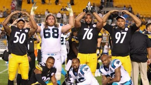 Ryan Shazier, Andrew Norwell, Mike Adams and Cam Heyward strike the O-H-I-O on Heniz Field.