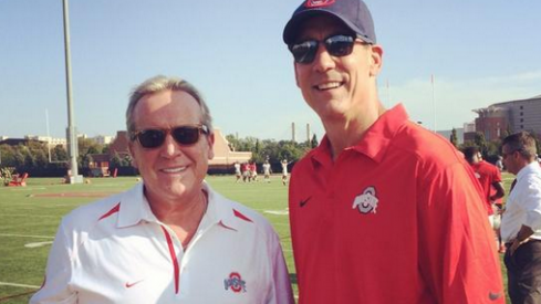 ESPN's Brad Nessler and Todd Blackledge were forced to change out of blue shirts today at practice.
