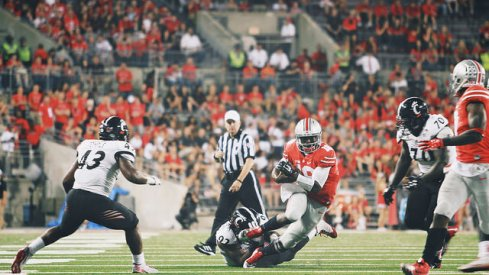 J.T. Barrett bosses up against Cincinnati.